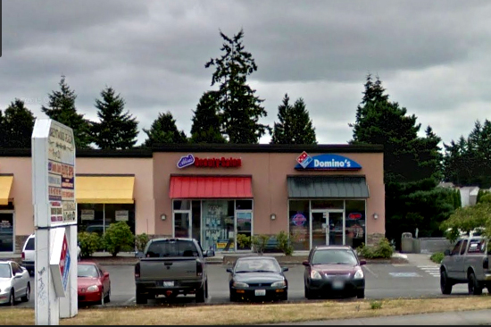 The stabbing took place behind this Domino's Pizza location at 22914 Highway 99.