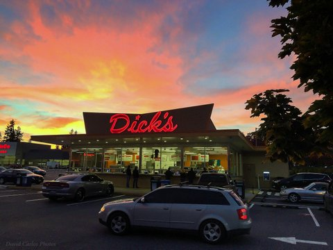 The sun sets behind Dick's Drive-In Thursday  night. (Photo by David Carlos)