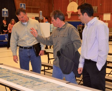 Dave Van Horn, who lives in unincorporated Snohomish County just north of Edmonds, discusses the Olympic View Drive route with Edmonds City Engineer Rob English, left, and Transportation Engineer Bertrand Haus.