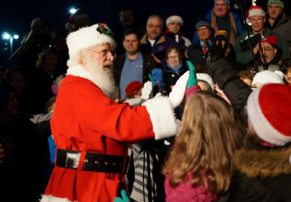 "Santa yells out to the kids, ""Give me a high five!"""