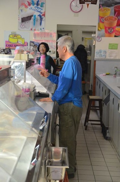 Baskin-Robbins owner John Kim serves customers.