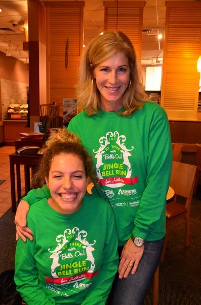 Lauren Little and mom JoAnne Little model this year's Jingle Bell Run t-shirt.