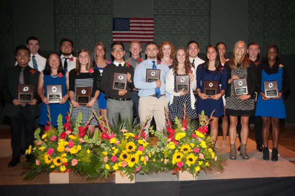 The 17 scholar athletes honored Wednesday night pose for a group shot. (Photos by Karl Swenson)