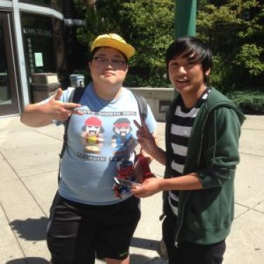 Edmonds CC students Choi Jae and Scott Tan wander campus in search of Pokémon. Tan isn't worried about the game draining his cellphone battery. He's always prepared to catch'em all with a spare charger and battery.
