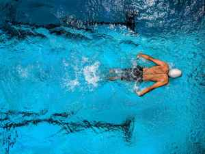 Swimmer performing a backstroke.