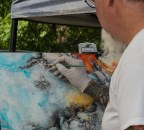 Watch art being made at the farmers market