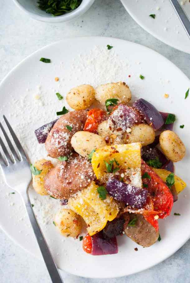 baked gnocchi sausage sheet pan dinner on a plate with parmesan cheese