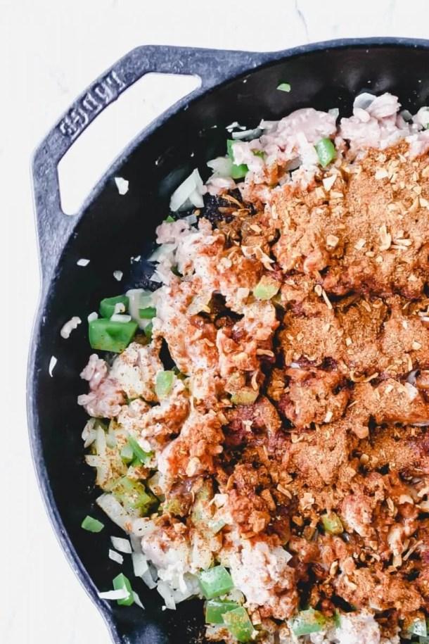 mexican tater tot hotdish - turkey and taco seasoning in pan