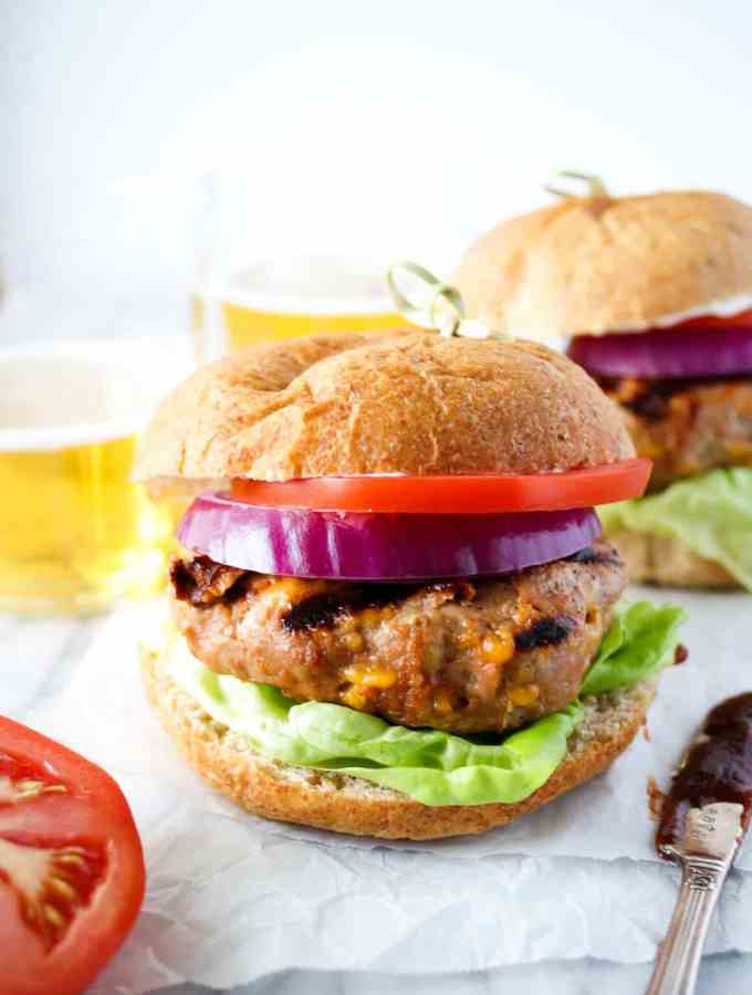bbq turkey burger with lettuce, tomato and onion