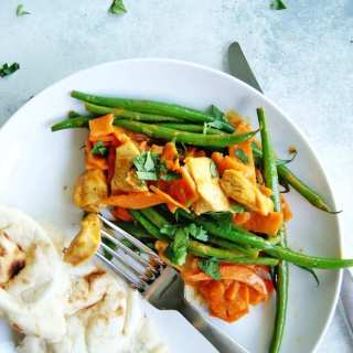 Easy Trader Joe's meal ideas for a quick dinner at home: chicken, sweet potatoes, and green beans all cooked together in a flavorful thai curry sauce.