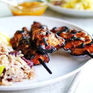 Easy Trader Joe's meal ideas for a quick dinner at home: pre-seasoned jerk chicken is paired with coconut rice and beans.