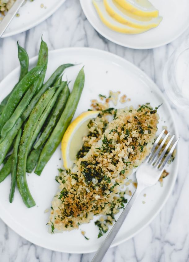 panko fish on a white plate with green beans