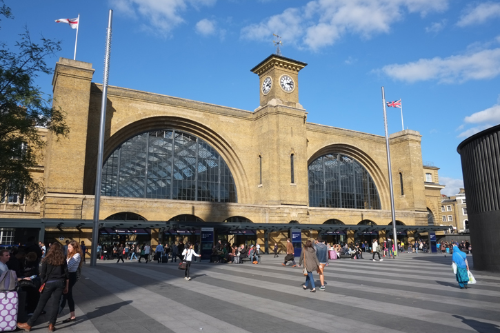 The Front Entrances of Kings Cross Station. This station was designed by Lewis Cubitt and completed in 1950. This images shows the open spaces of the Kings Cross Square.