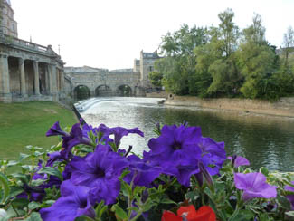 Pulteney Bridge and the weir on the River Avon in Summer.
