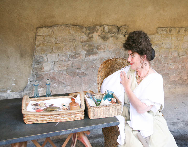 Roman Baths: An Actress playing a role in the Roman period and showing the techniques of skin care of that period.