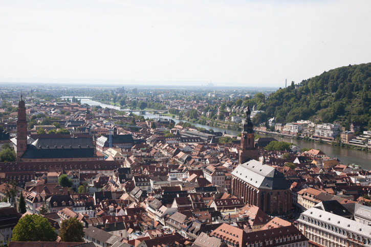 The panoramic view of Heidelberg city. There is a Jesuit Church on the left and the Cathedral on the right of the image. The River Neckar comes from hills and flows into the plains. Heidelberg is at the point where the hills meet the plains.