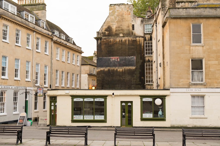 """This is an example of a building surface that has not been cleaned. The buildings on either side were built at about the same time but have been cleaned. Just imagine, when I first visited Bath, most of the buildings had this """"black"""" colour. It was really depressing."""