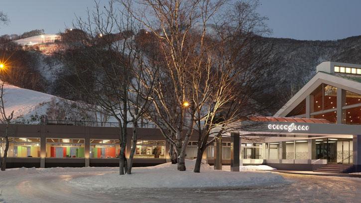 An evening view of GreenLeaf Hotel in Niseko Village