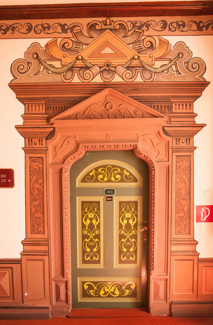 The decoration of one of the bedroom doors of the Hotel zum Ritter.