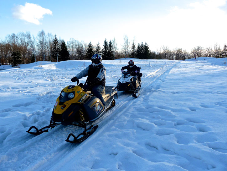 Riding a snow mobile in Niseko Village