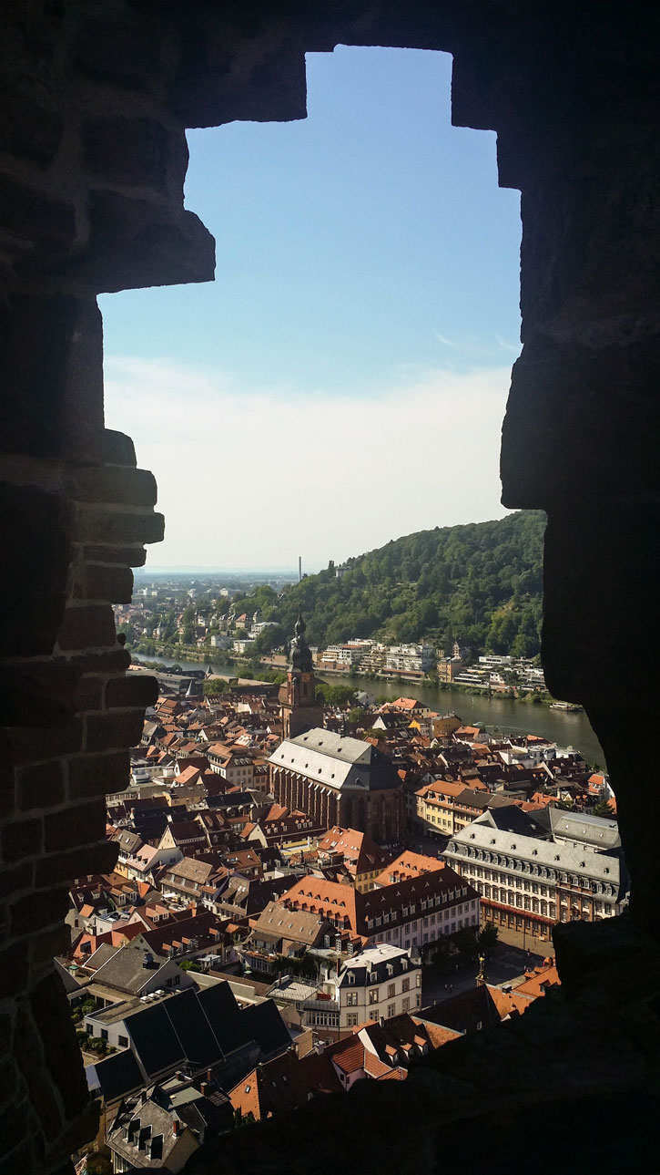 """A """"keyhole"""" image of the Heidelberg Cathedral from one of the standing walls of the Heidelberg Castle. At one time, the cathedral was divided into two. One for the Protestants and the other for Catholics. The partition was installed in 1706 and removed in 1936."""