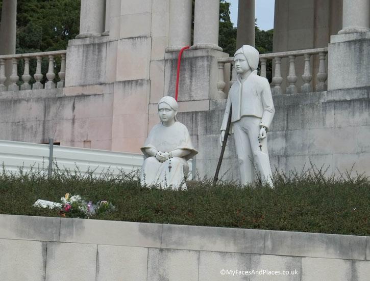 The statues of Jacinta and Francisco Marto in the Fatima Shrine.