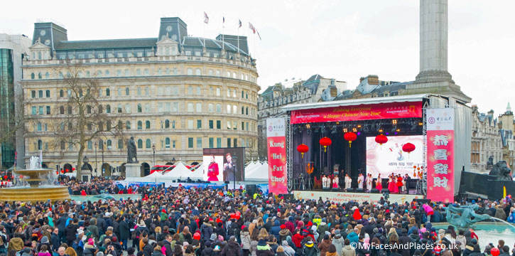 The crowds in Trafalgar Square watching the performances on the stage in celebration of the year of the Monkey.