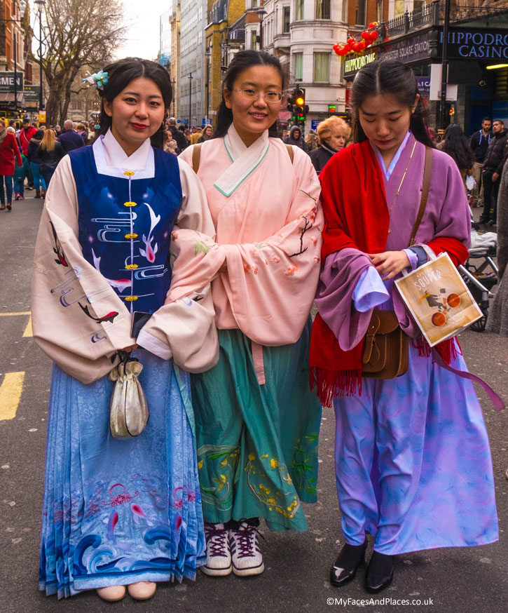 Three Ladies in their traditional Chinese costumes coming for the Chinese New Year Celebrations in London.
