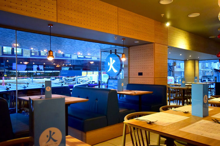 "The striking interiors of Chi Kitchen. It uses the Chinese word for ""Fire"" with restful shades of blue."