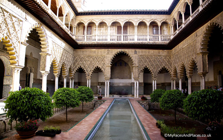 """"""" Sunken Garden of Paradise"""" with the reflecting pool at the Royal Alcazar in Seville."""