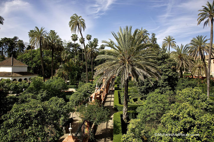 The serene garden with Moorish influence of the Royal Alcazar in Seville.