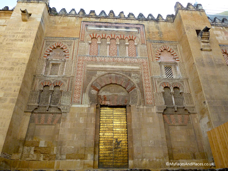 The gorgeous facade with the golden door of the Cordoba Mosque-Cathedral.