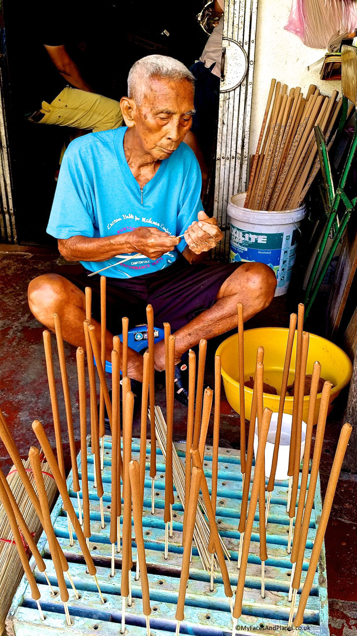 """Lee Beng Chuan (Stewart Lane) - Joss stick maker. Mr Lee, the artisan, uses sandalwood from Western Australia for his handmade joss sticks, also known as """"The Incense of the Gods"""".This is one of the traditional artisans working in the World Heritage Site."""