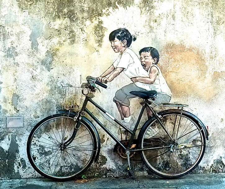 """""""Little Children on a Bicycle"""" (Armenian Street): It depicts a little girl taking her younger brother on a real bicycle ride. From the expressions of their faces, you can see the joy and happiness which brings a cheer to anyone looking at them."""