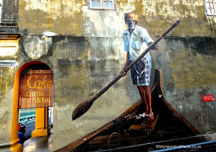 """The Boat Man"" (Stewart Lane/Klang Street). This painting not only shows an Indian man, one of the races in Multicultural Penang but also reflects this area's association with Sea Faring. This alley way had the nickname of ""Boat Alley""."