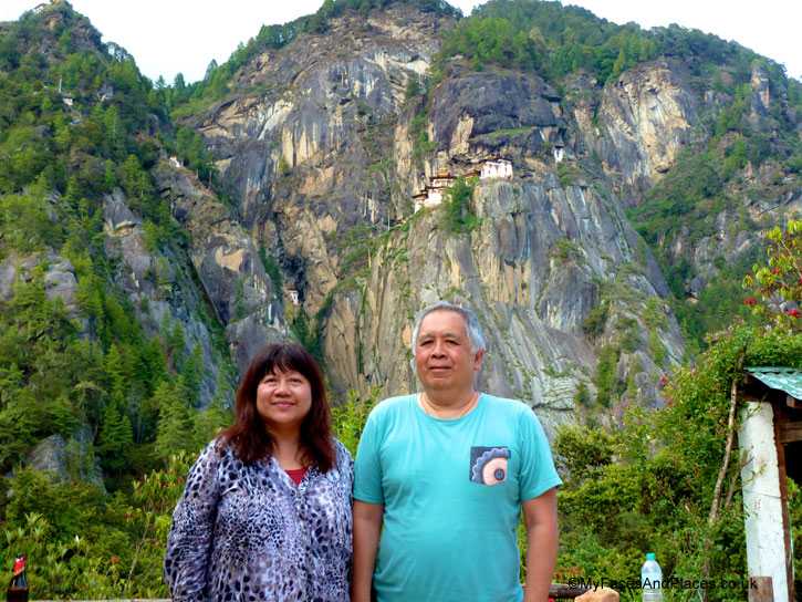 Helen and Michael Oon with a stunning backdrop of Tiger's Nest - Bhutan Tiger's Nest