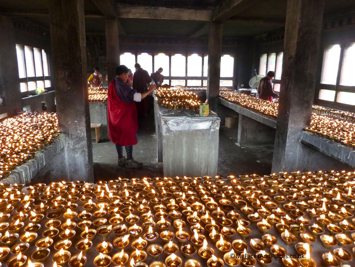 Butter lamps are lit up as offerings to the gods - Bhutan the Beautiful