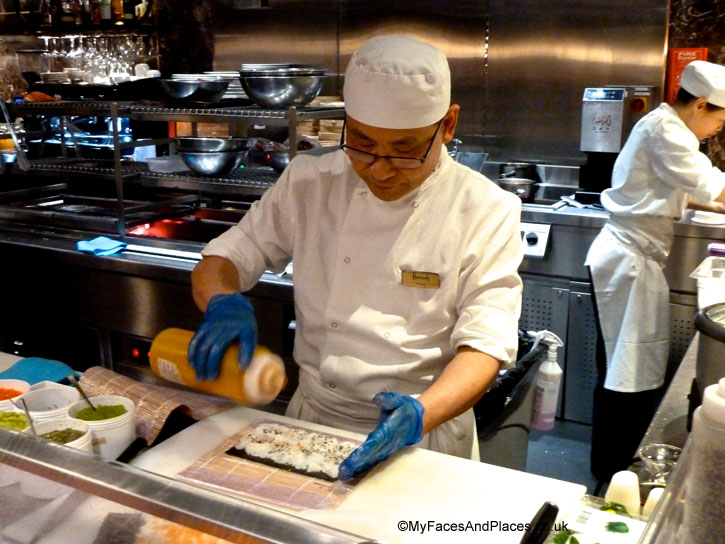Chef crafting a sushi roll with salmon and seaweed in Chai Wu @ Harrods.