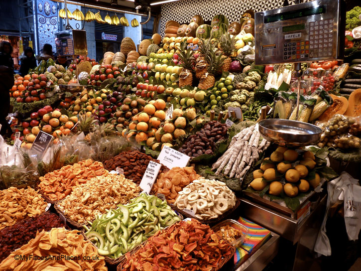 Sumptuous display of fresh and dried fruits at La Boqueria Market in Barcelona, Spain