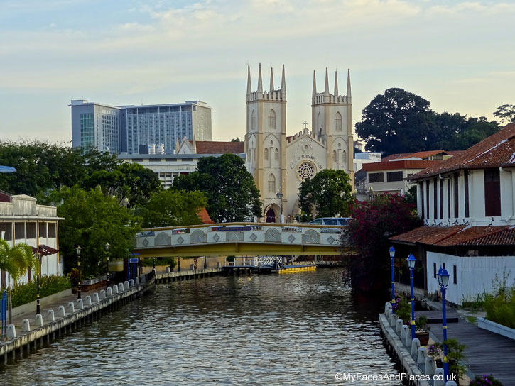 The beautiful riverscape of Malacca with St Francis Xavier Church in the background