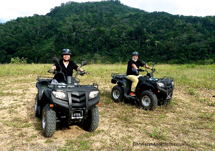 Helen and Michael rocking it on the quad bikes in Sabah