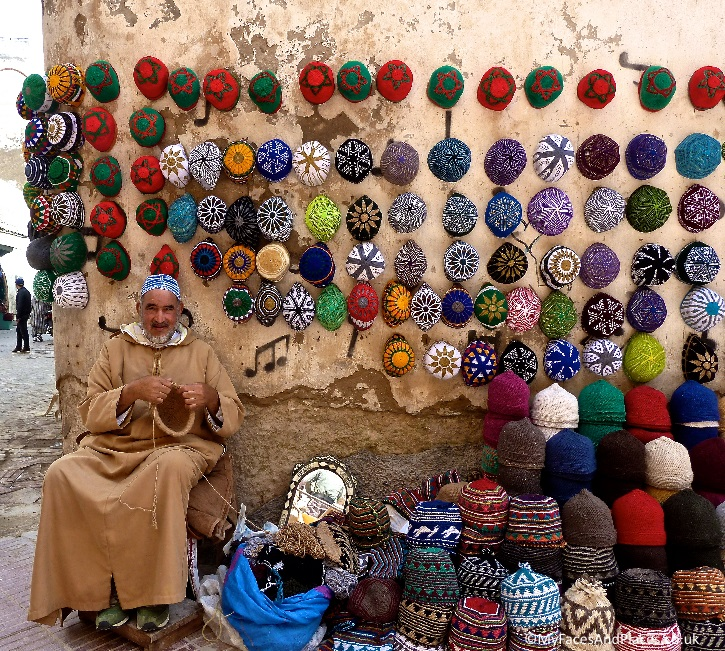 A jolly skullcap maker displayed his craft like work of art