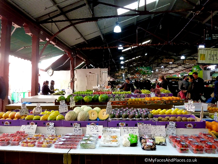 Stalls heaving with fresh products at the bustling Queen Victoria Market