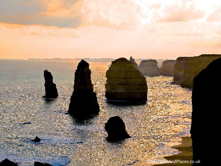 The Twelve Apostles bathed in a sunset glow