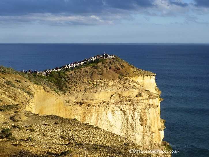 Visitors on the cliff admiring the coastal view