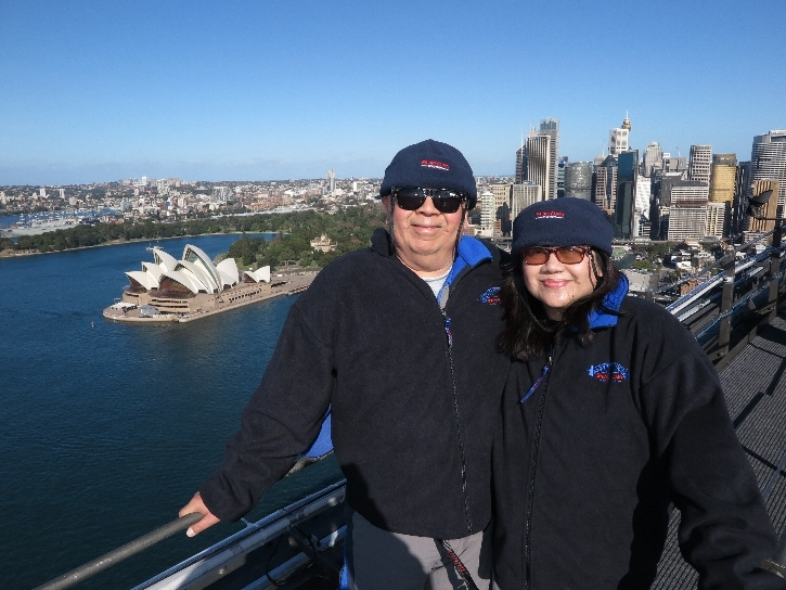 Sydney Stopover - Michael and Helen on the summit of Sydney Harbour Bridge with BridgeClimb photo credit: BridgeClimb Sydney