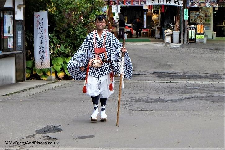 A Yamabushi in his religious attire at Sanjin Gosaiden shrine