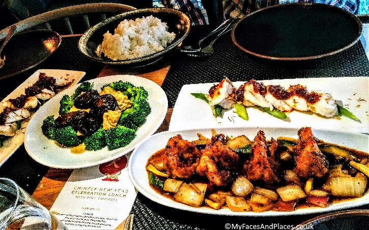 A festive menu of steamed monk fish, tiger prawns and stir fried broccoli with tofu