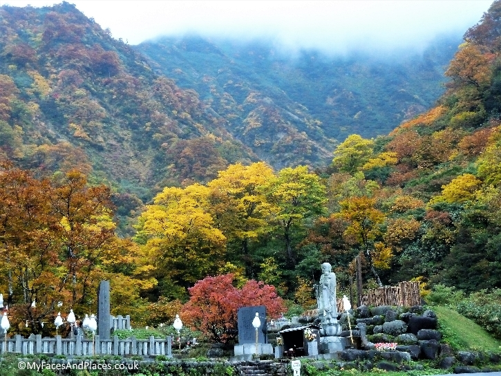 Sacred shrines and statue at Mt Yudono