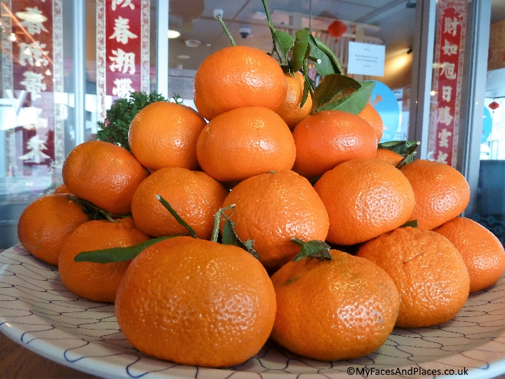 "Oranges for ""gold"" and good fortune"